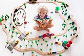 Child With Toy Train. Kids Wooden Railway. poster
