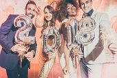 Party people women and men celebrating new years eve 2018 with sparklers and Champagne  poster