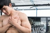 Muscular Male Having Pain On Shoulder In Gym.  Young Man Injure While Workout In Fitness Center. Bod poster