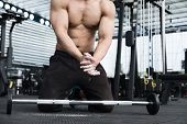 Muscular Man Clap Hand In Fitness Center. Male Athlete Pump Up Muscle In Gym. Weightlifter Work Out poster