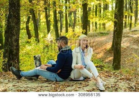 poster of Autumn Couple. Hipster Girl Browsing Internet On A Phone - Texting And Communicating Outdoors. Yyoun