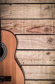 Acoustic Guitar On Vintage Style Wood Background. Copy Space With Musical Guitar Instrument poster
