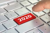 Keyboard With Text 2020 And Finger Pushing The Enter Button. Color Button On The Gray Silver Keyboar poster