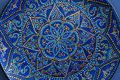 Decorative Ceramic Plate With Blue And Golden Colors, Painted Plates, Closeup. Decorative Porcelain  poster
