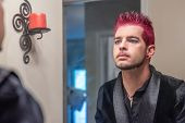 Alternative Caucasian Male With Pink Spiked Hair Gazing Into The Mirror. poster