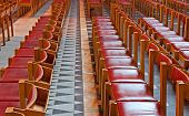 Rows Of Red Wooden Chairs In Church