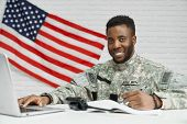 Positivity Soldier And Worker Of American Army Writing Documents, Using Laptop And Smiling At Camera poster