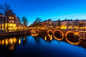 Canals Of Amsterdam At Night. Amsterdam Is The Capital And Most Populous City Of The Netherlands. poster