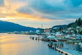 Sunset From The Coast In Ketchikan, Alaska. Landscape Coastal View Along The Ocean With Buildings Al poster