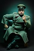 picture of sergeant major  - The evil dictator sitting in a chair - JPG
