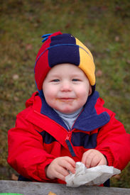 stock photo of doritos  - One year old boy with a messy face - JPG