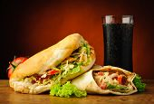 stock photo of shawarma  - still life with traditional turkish doner kebab shawarma and cola drink - JPG