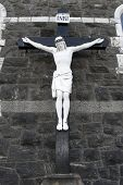 picture of inri  - a cross of the crucifiction on the outside wall of a church in Donegal Ireland - JPG