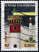 A stamp printed in France shows the flagship ouistreham in the night