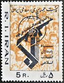 A stamp printed in Iran shows the drawing of a hand holding up a gun on a background of faces