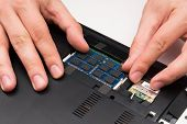 Man Installing Memory. Laptop Ram Upgrade