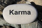 picture of karma  - Positive reinforcement word Karma engrained in a rock - JPG