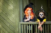 foto of antichrist  - Portrait of two Halloween girls looking at camera - JPG
