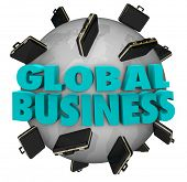 The words Global Business around a world covered in black leather suitcases to illustrate expanding