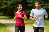 pic of spare  - Portrait of cheerful Caucasian couple running outdoors - JPG