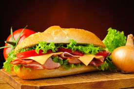 foto of deli  - still life with delicious deli sub sandwich and vegetables - JPG
