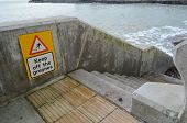 Keep off sea groyne sign.