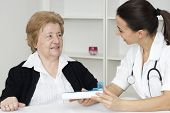 Senior Woman With Nurse