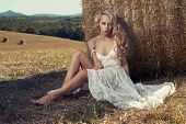 pic of hayfield  - Photo of sexy blonde in a field with haystacks - JPG