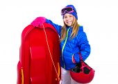 Blond kid girl with red sled and snow equipment helmet and goggles on white background