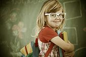 stock photo of little school girl  - Cheerful colorized retro fashion little girl at school room having education activity - JPG
