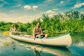 stock photo of canoe boat man  - Exhausted Men Sailing In A Canoe At Summertime - JPG