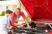 image of grandfather  - Grandfather And Grandson Working On Restored Classic Car - JPG