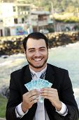 stock photo of brazilian money  - business man with money brazilian on the hands - JPG
