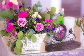 picture of dowry  - Flower arrangement in a basket decorate the wedding table in purple tones - JPG