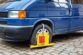 stock photo of illegal  - Lock wheel of illegally parked car on the street