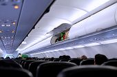 picture of begging  - Picture of luggage beg compartment inside the aircraft - JPG