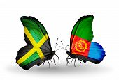 stock photo of eritrea  - Two butterflies with flags on wings as symbol of relations Jamaica and Eritrea - JPG