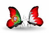 foto of bahrain  - Two butterflies with flags on wings as symbol of relations Portugal and Bahrain - JPG
