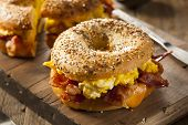 foto of deli  - Hearty Breakfast Sandwich on a Bagel with Egg Bacon and Cheese - JPG