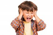 stock photo of shout  - Frustrated little Boy shouting and holding head in hands while standing isolated on white - JPG