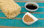 foto of condiment  - A buch of Chow Mein noodles and bowls with condiments - JPG