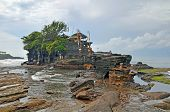 picture of tanah  - The famous Hindu temple of Tanah Lot set on a rock and only accessible at low tide Bali Indonesia - JPG