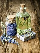 foto of massage oil  - massage oil herbal soap and bath salt with fresh lavender flowers on wooden background - JPG