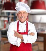 stock photo of buffet lunch  - Senior professional chef man in modern kitchen - JPG