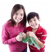 picture of irresistible  - A brother and sister getting ready to pop bubble wrap - JPG