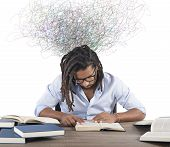 picture of concentration man  - Concentrated man reading book that inspires him - JPG