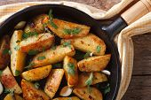 foto of baked potato  - potatoes baked in a pan closeup rustic style horizontal view from above - JPG