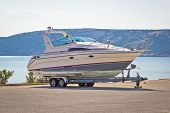 image of travel trailer  - Boat on a trailer by the sea Pag island - JPG