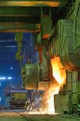 stock photo of blast-furnace  - Pouring of liquid metal in a steel plant - JPG