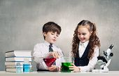 foto of experiments  - Two cute children at chemistry lesson making experiments - JPG